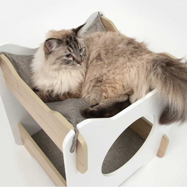 Vesper Cabana is a two-toned piece of cat furniture with a hideout at the bottom and a relaxing hammock on top